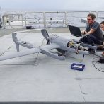 Scott Bowers and Sophia Brumer retrieve information from an HQ-60B drone (Unmanned Aerial Vehicle). The data collected will provide information about processes affecting air-sea exchange.